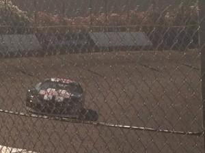 Simon driving a NASCAR.