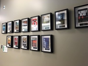 The bestsellers wall at Thomas & Mercer Publishers. Two of Simon's books featured.